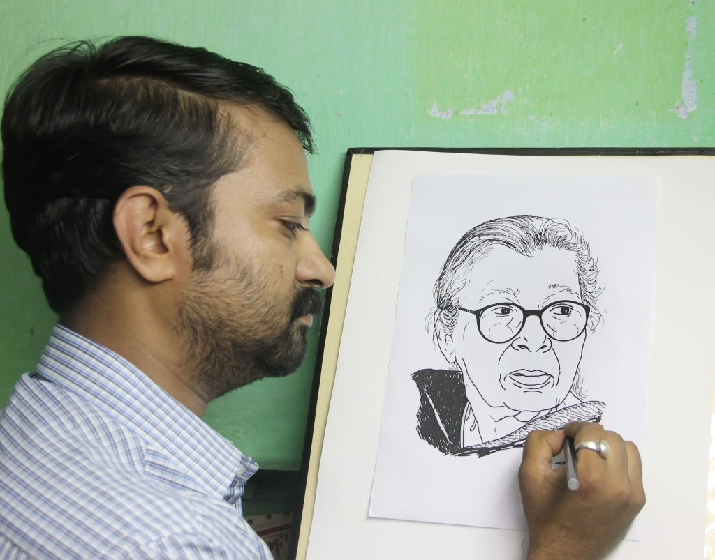Sujit Mandal drawing portrait of author Mahasweata Devi. Picture by Abhi Ghosh