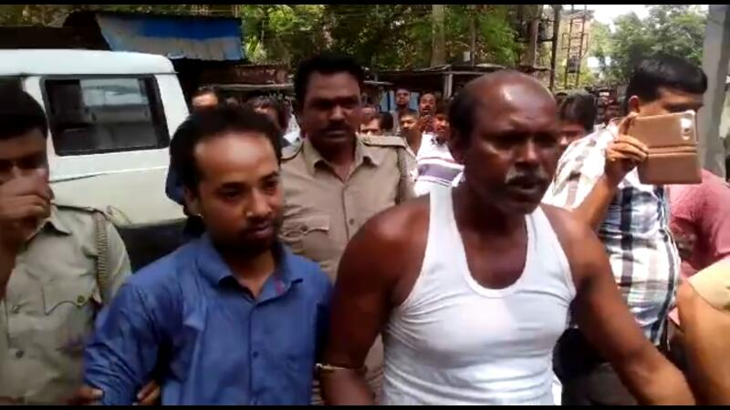Accused Sankar Biswas and Kamal Majumder being taken to court in Ranaghat. Picture by Tito Chakraborty