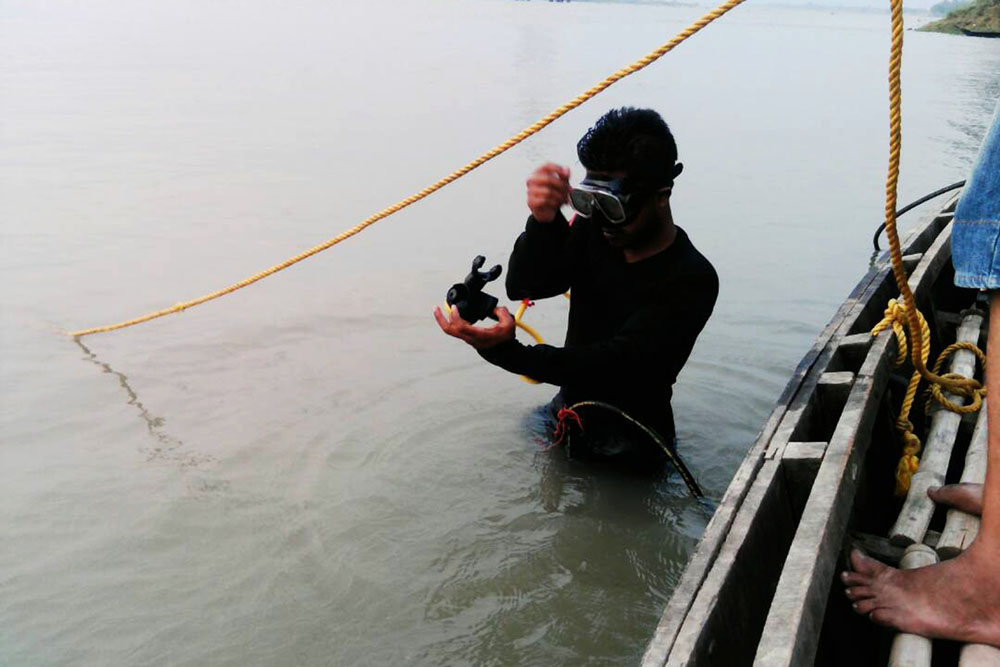 A diver busy in rescue operation for the drowned boys
