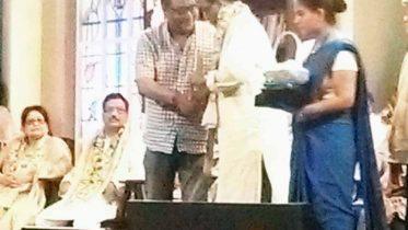Chandan Sen receiving Dinabandhu puraskar from information and culture minister Indranil Sen on Friday.