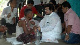 CPM MP Ritabrata Banerjee, part of SFI team speaking to Sagar Mondal's father Susanta Mondal. Picture by Deba Mukherjee