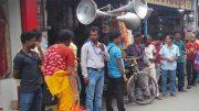 Businessmen persuading crowd using loudspeakers,