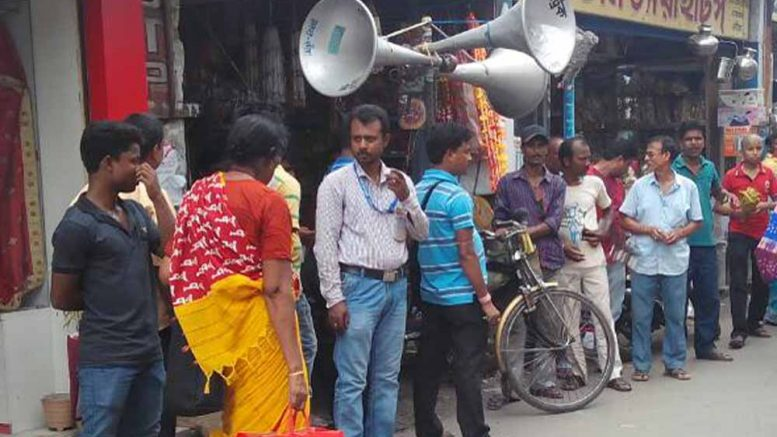Businessmen persuading crowd using loudspeakers,