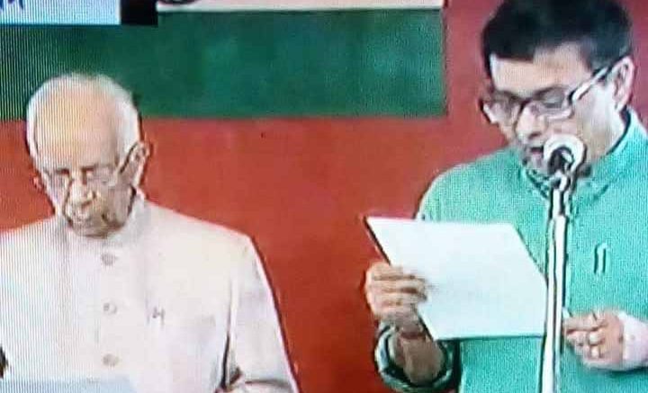 Ujjwal Biswas being sworn in as Minister by Governor Kesharinath Tripathy