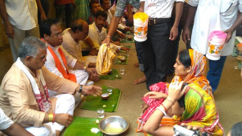 Dilip Ghosh and BJP leaders being served lunch at the residence of Ananda Ghosh in Bethuadahari