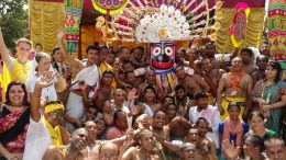 The deity of Lord Jagannath being taken for installation to the chariot in Rajapur by the devotees. Picture by Subrata Biswas