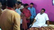 Rahul Sinha speaking to members of a family in Pairadanga.