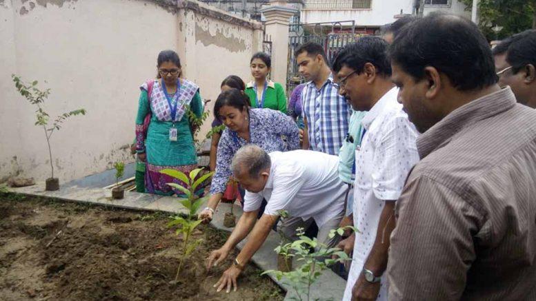 Zilla Sabhadhipati Bani Kumar Roy planting a sapling of tree.