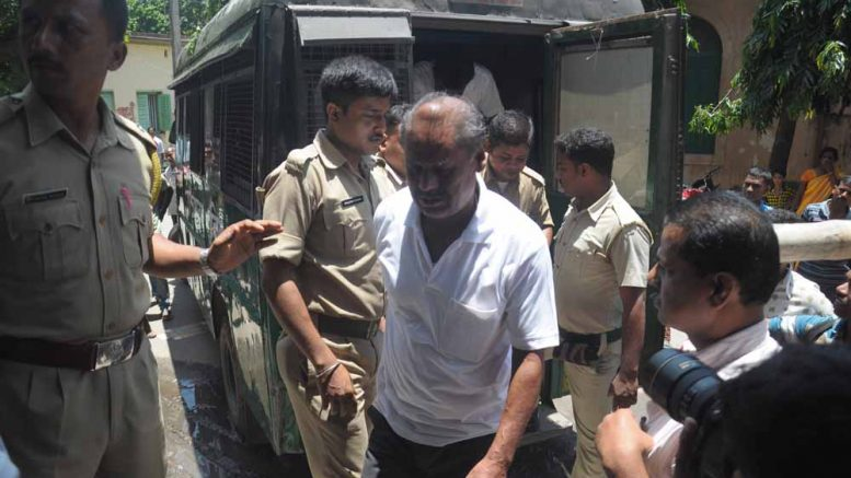 Convicted Lankeswar Ghosh being taken to court in Krishnanagar. Picture by Pranab Debnath