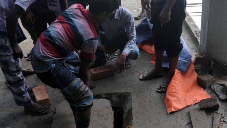 The villagers gathered around the manhole of the septic tank in Chapra, Picture by Pranab Debnath