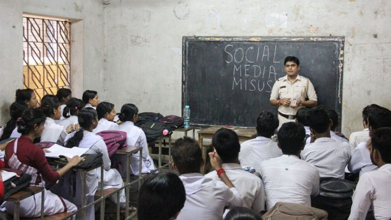 Prasenjit Das, a sub inspector of Santipur police station delivering an awareness lecture at a class room in Rabindra Vidyapith. Picture by Abhi Ghosh