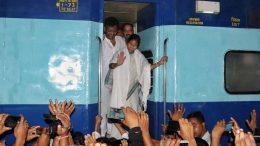 Chief minister Mamata Banerjee waves to passengers at Krishnanagar railway station. Picture by Pranab Debnath
