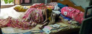 Binapani Biswas lying dead on her bed