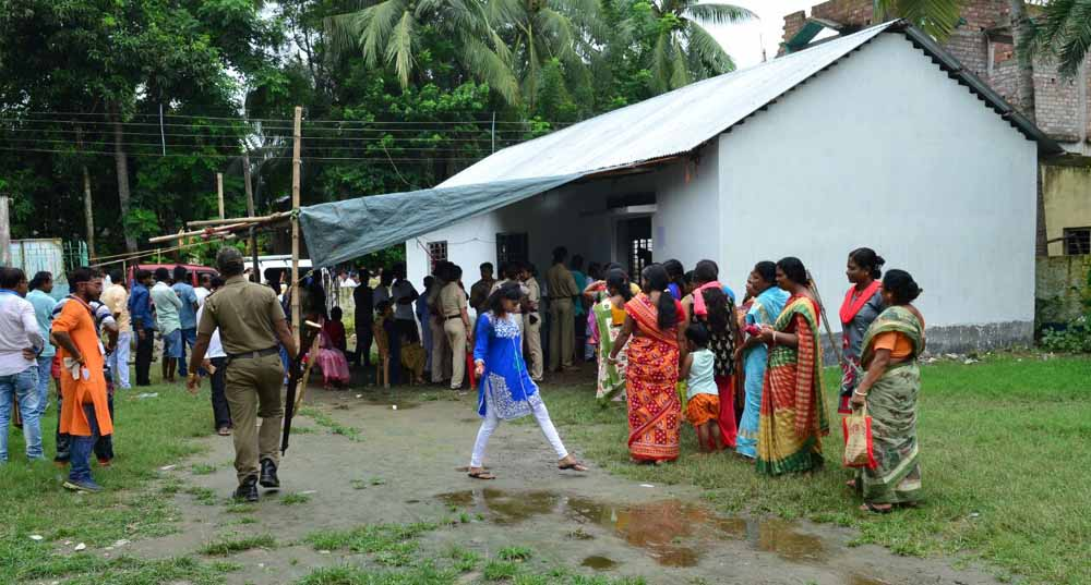 Voters in a queue to caste their votes in Cooper's Camp