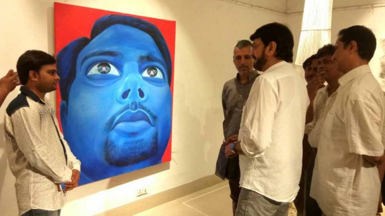 Actor Chiranjeet watching a creating at the Academy of Fine Arts Gallery. Picture courtesy: Faruq Ahmed (KU)