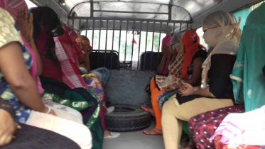 Arrested girls being taken to court in police vehicle