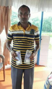 Mohammed Hafizul Bixswas with the Bangladeshi currency. Photo courtesy BSF