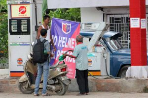 Fuel for bike being sold to biker without helmet flouting official order