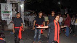 Krishnanagar Sinchan theatre group members performing street play 'Taharush' on Karimpur road near Ghurni. Picture by Pranab Debnath