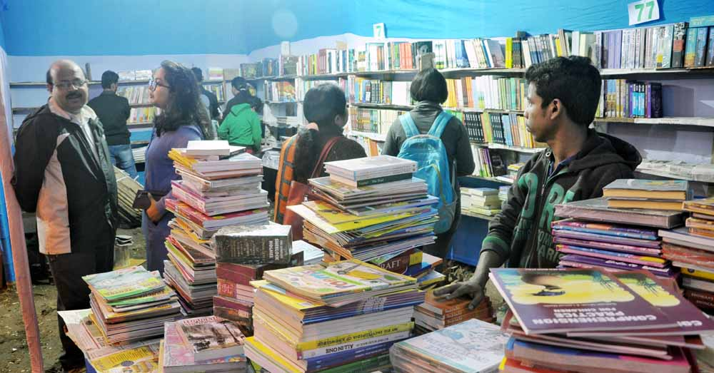 Book lovers in a stall at the venue of the fair