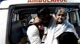 Matua Matriarch Binapani Debi being taken inside of JNM Hospital in Kalyani