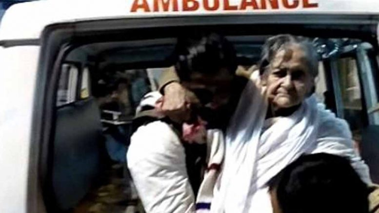 Matua Matriarch Binapani Debi being taken inside of JNM Hospital in Kalyani