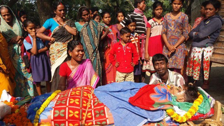 Bereaved family members with body of Sanat Mandal