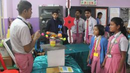 A student showing a science model at BDN school canpus