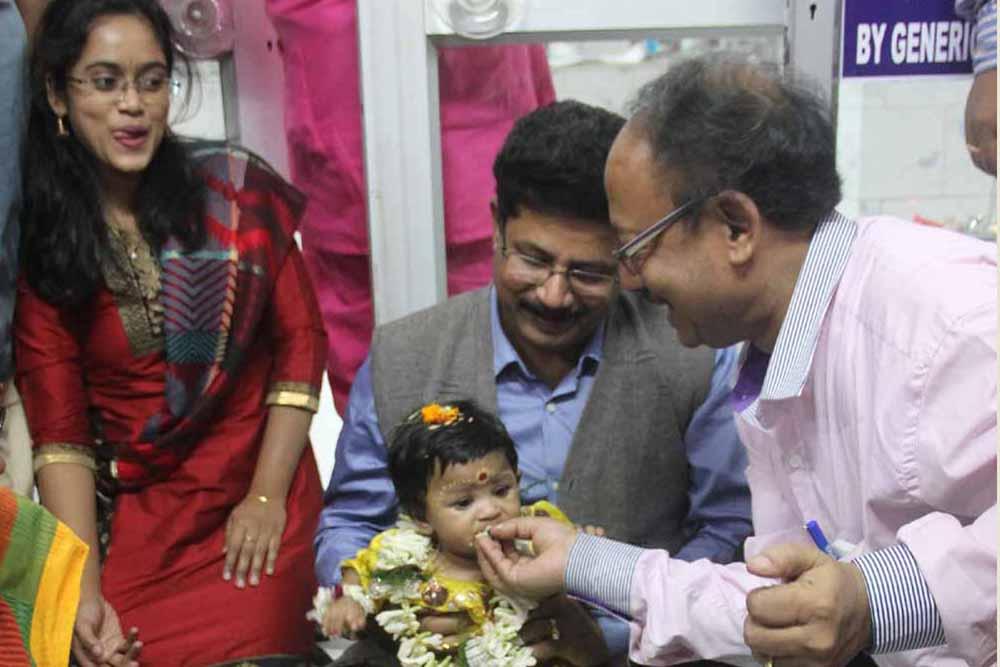 Jhulan on the lap of Hospital superintendent Dr.SN Sarkar while Pediatric AK Bera feeding her rice