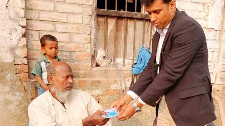 Kaliganj BDO Nazir Hossain handing over Swasthya Sathi card
