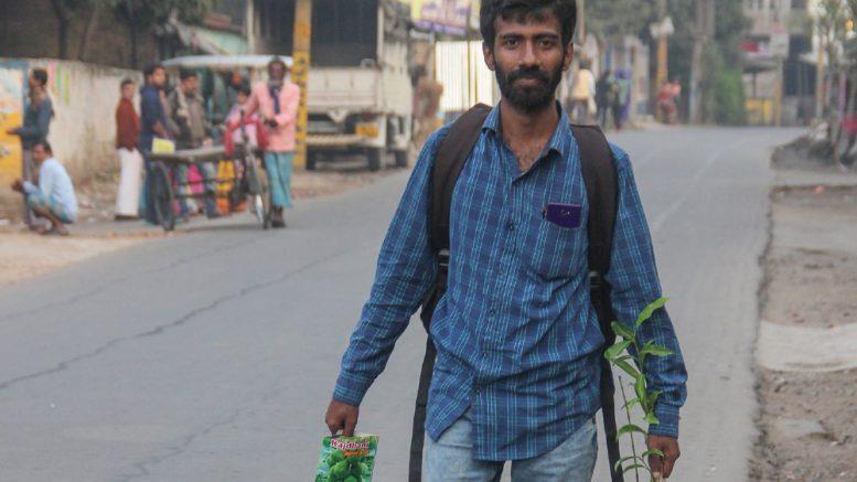 Rahul Deb Biswas walking along NH34 on Monday