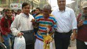 An elderly vagrant in a new attire with Santipur police OC Raja Sarkar (left)