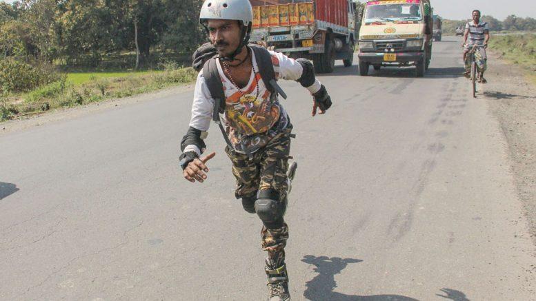 Partha Bhattacharjee skating on NH34 near Santipur.