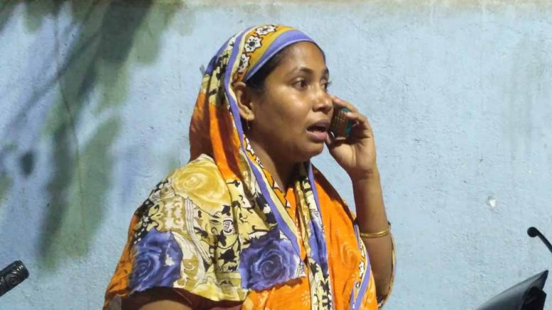 Girl's mother Anjuwara Biwi brokes down while speaking to a relative over phone at Chakdaha police station.