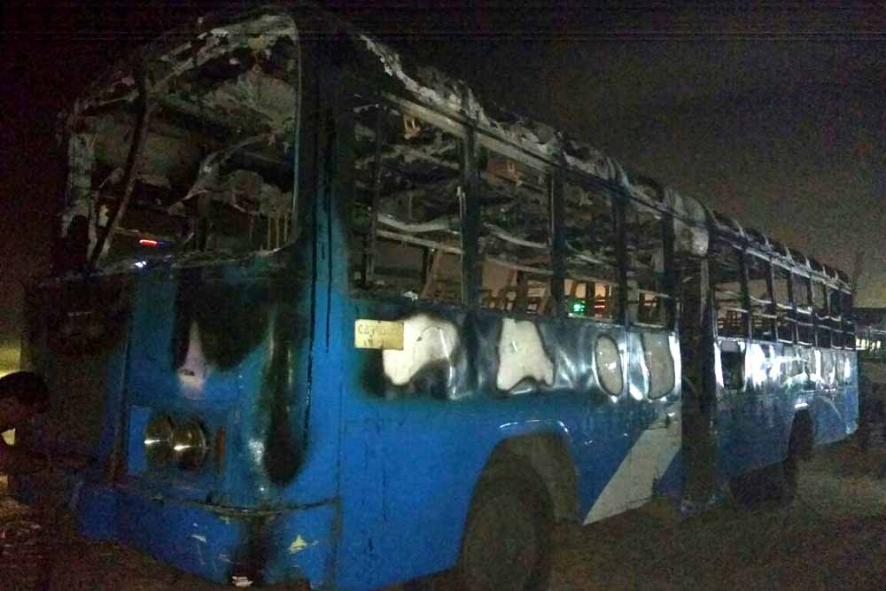 a state bus torched by mob in Debagram