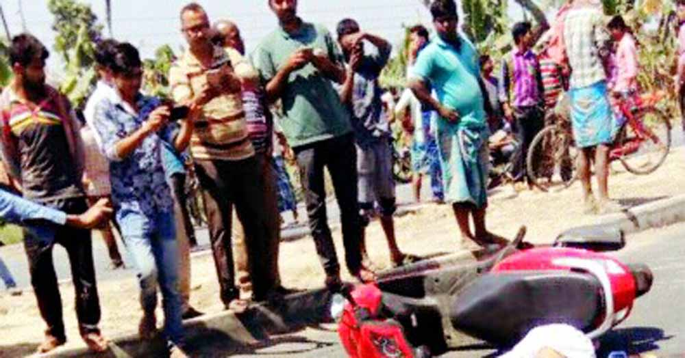 The scooter which the victims were riding lying on NH34
