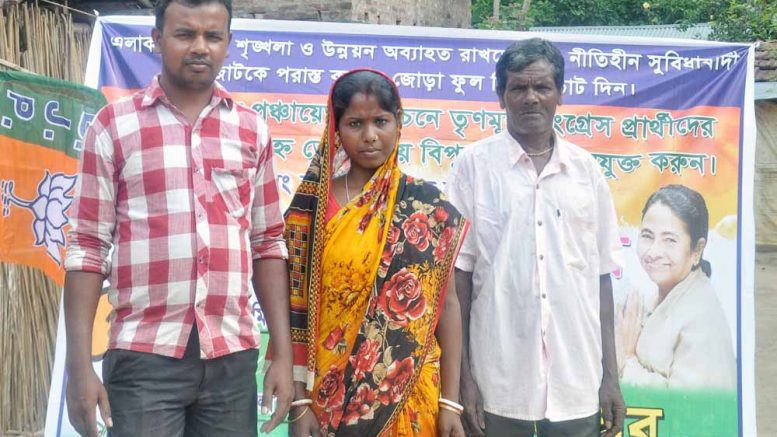 Bablu Roy (TMC), Aduri Roy (BJP) and Laxman Roy (CPM backed Independent) in front of their home in Majhdia