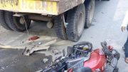 Motorbike of Rakesh Kundu lying on the road near the lorry