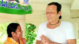 Gadadharpran Das speaking to Trinamul's gram panchayat candidate Namita Mandal.