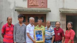 Saser Kangri expedition team of MAK with a portrait of Pemba Sherpa