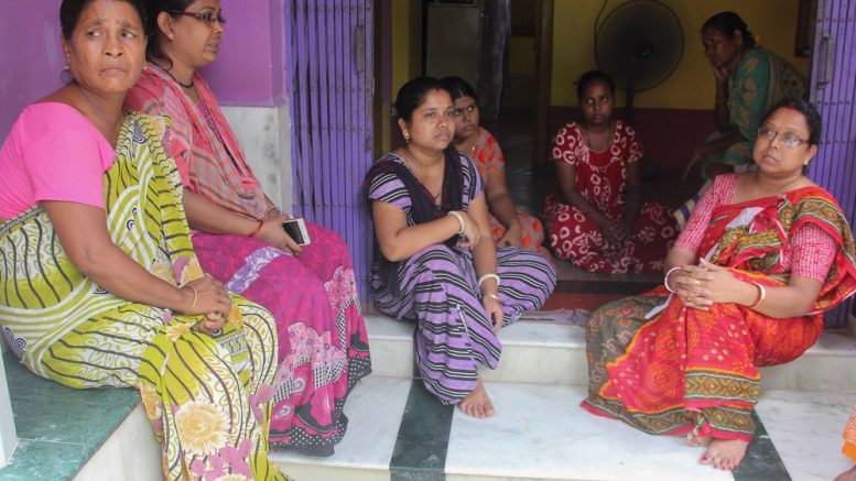 Bereaved family members of deceased Badal Mandal