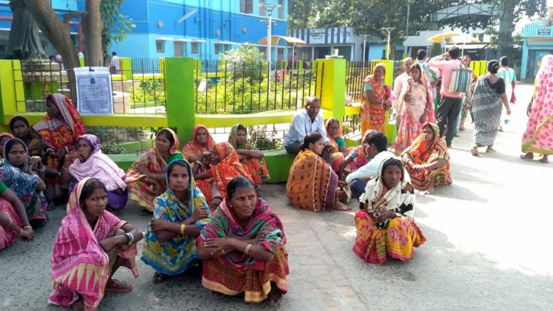 The anxious family members wait outside the Santipur State General Hospital