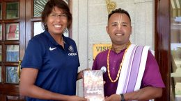 Former Indian Women's cricket team captain Jhulan Goswami receiving a 'Bhagawad Gita' from an official of Iskcon