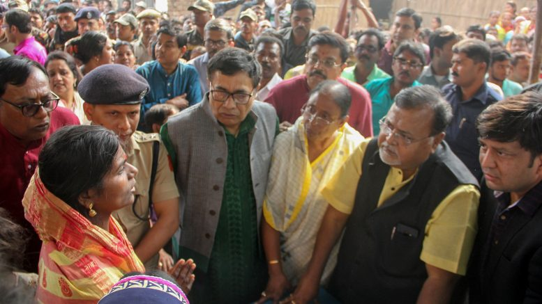 Bhagirathi Mahato and other women speaking to minister Partha Chatterjee