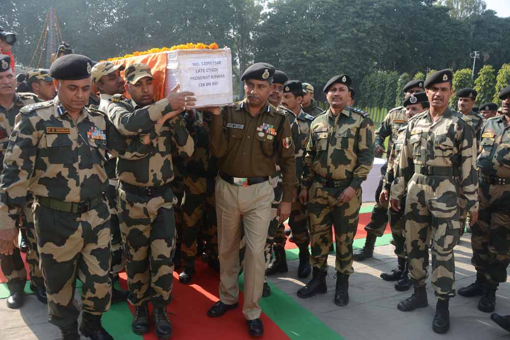 Mortal remains packed in a coffin being taken for last tributes in Jammu