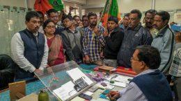 BJP leader Mahadeb Sarkar with party activists at Krishnagar post office on Monday