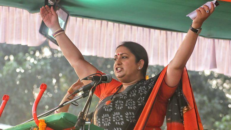 Union Textiles Minister Smriti Irani speaking at a BJP rally in Krishnanagar Sandhyamathpara on Thursday.