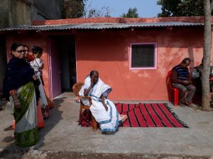 Jyotsna in front of renovated home