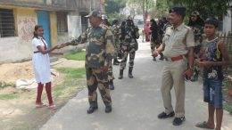 Central Force personnel distributing chocolates