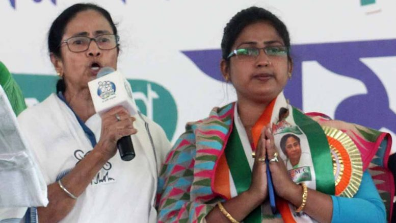 Mamata Banerjee introducing party candidate Rupali Biswas
